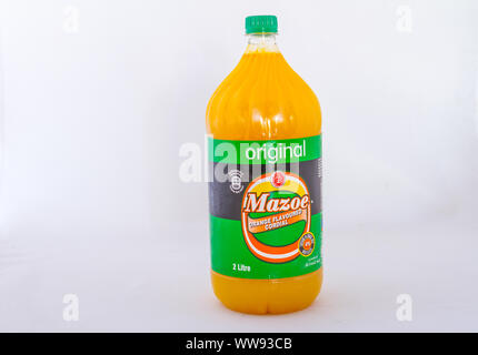 Alberton, South Africa - a bottle of Mazoe orange flavored cordial produced in Zimbabwe isolated on a white background image with copy space - Stock Photo