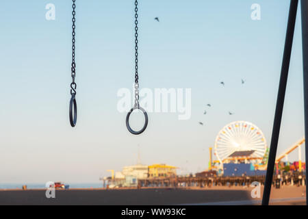 Travelling Rings for exercise at muscle beach jungle gym on in Santa Monica, California at early morning - Stock Photo