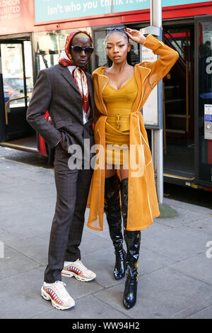 London, UK. 13th Sep, 2019. Two fashion enthusiasts are seen wearing fashionable outfits at the London Fashion Week. Credit: SOPA Images Limited/Alamy Live News - Stock Photo