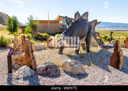 Jensen, USA - July 23, 2019: Visitor center art statue in Dinosaur National Monument Park outside in Utah - Stock Photo