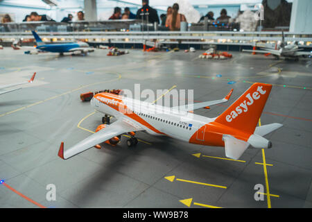 a scale model easyJet Airbus A320 sits parked on the tarmac at the famous Knuffingen Airport at Miniatur Wunderland in Hamburg - Stock Photo
