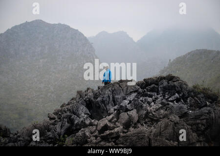Hiking in Sa phin (site 23) in the Dong Van Karst Plateau Geopark in Ha giang Province, Vietnam - Stock Photo