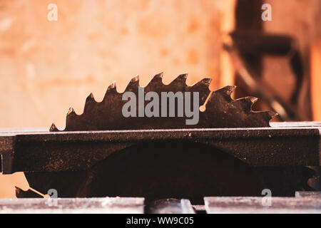 circular saw with carpenter store blur background - Stock Photo