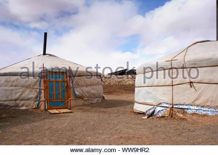 Gers, Mongolian tent or yurts in Tsagaan Suvraga «white stupa» area in the Gobi desert on a bright sunny day, Mongolia. - Stock Photo