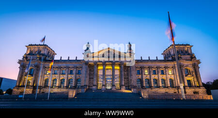 German parliament Reichstag building in Berlin at early in the morning during sunrise - Stock Photo