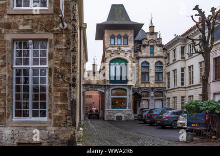Ghent, Belgium - December 16, 2018: Interesting small narrow medieval house in the Ghent center. - Stock Photo