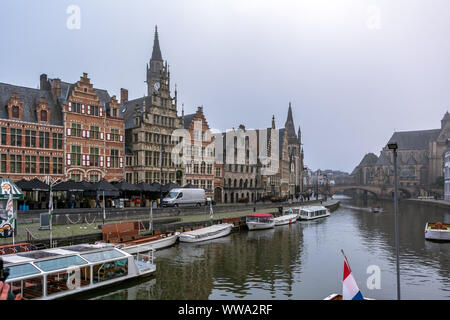 Ghent, Belgium - December 16, 2018: General view of the Graslei with boats on the Leie river in the foreground. - Stock Photo