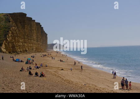West Bay, Dorset, UK. 14th Sep, 2019. Locals and visitors alike enjoy the sunshine at West Bay on the Dorset coast as the UK basks in an Indian Summer. Credit: Tom Corban/Alamy Live News
