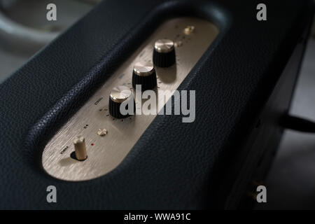 Close-up detail of sound volume controls in vintage style. - Stock Photo