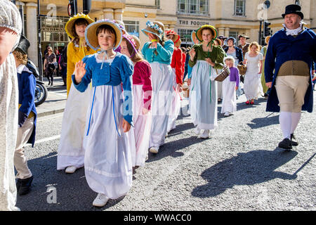 Bath, Somerset, UK. 14th Sep, 2019. Jane Austen fans are pictured taking part in the world famous Grand Regency Costumed Promenade. The Promenade, part of the 10 day Jane Austen Festival is a procession through the streets of Bath and the participants who come from all over the world dress in 18th Century costume. Credit: lynchpics/Alamy Live News - Stock Photo