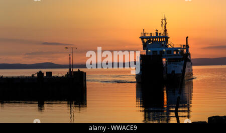 Caledonian MacBrayne car and passenger ferry approaches Largs, North Ayrshire, Scotland, UK - Stock Photo
