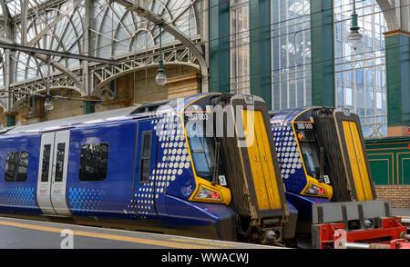 British Rail Class 380/0 Desiro electric multiple-unit trains at Glasgow Central Railway Station, Glasgow, Strathclyde, Scotland, UK - Stock Photo