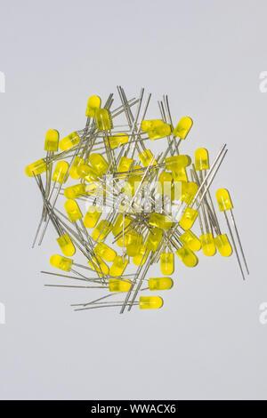close up image of 5mm yellow leds isolated on white background,pile of 5mm yellow leds. - Stock Photo