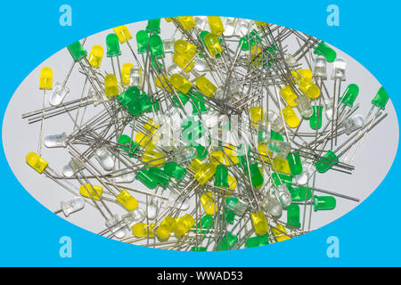 close up image of a pile of 5mm yellow, green crystal clear white leds isolated on white background. - Stock Photo