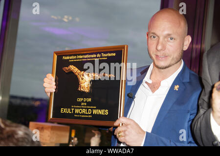 Paris, France. 13th Sep, 2019. Jean Eric De Saint Luc, President of the International Federation of Tourism awarded the CEP d'OR to David Zienkiewicz. - Stock Photo