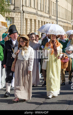 Bath, Somerset, UK. 14th September 2019. Jane Austen enthusiasts in Regency Period costume make a procession through the City. The annual festival draws Austen enthusiasts from all over the world, the procession of around 500 people in costume is the start of a week of Austen inspired events. This year the procession starts at Sydney Gardens makes a loop through the city passing many places Austen would have been familiar with, ending in the Parade Gardens. Credit: Mr Standfast/Alamy Live News - Stock Photo