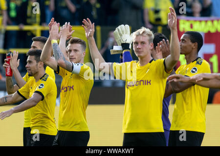 Dortmund, Germany. 14th Sep, 2019. Soccer: Bundesliga, Borussia Dortmund - Bayer Leverkusen, Matchday 4 at Signal Iduna Park: Dortmund's players Marco Reus and Julian Brandt (r) thank the fans. Credit: Bernd Thissen/dpa - IMPORTANT NOTE: In accordance with the requirements of the DFL Deutsche Fußball Liga or the DFB Deutscher Fußball-Bund, it is prohibited to use or have used photographs taken in the stadium and/or the match in the form of sequence images and/or video-like photo sequences./dpa/Alamy Live News - Stock Photo