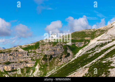 Auronzo alpine hut near the Three Peaks of Lavaredo, in the back Monte Campedelle and Col de le Bisse, Sexten Dolomites