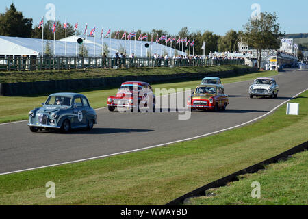 Goodwood Revival 13th September 2019 - St Mary's Trophy -  a gaggle of 1950's cars coming down the straight to Madgwicks Corner - Stock Photo