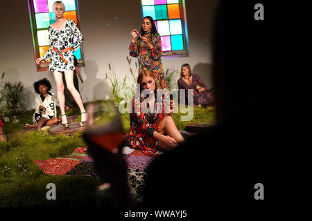 Models during the presentation of RIXO Spring/Summer 2020 London Fashion Week show at the Old Chelsea Postal Sorting Office, London. - Stock Photo