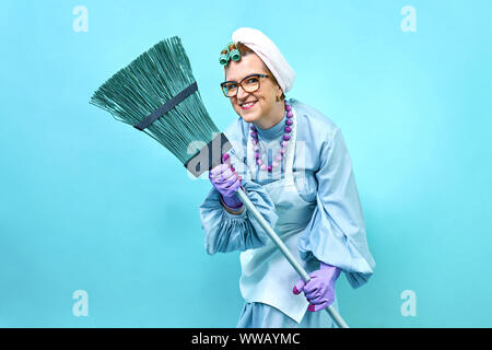Cleaning Lady smile Fun. Elderly funny housewife fooling around with a broom. Full body isolated. Comical cleaning lady, old woman funky - Stock Photo