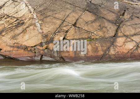 Junction Creek rapids in early spring, Greater Sudbury, Ontario, Canada - Stock Photo