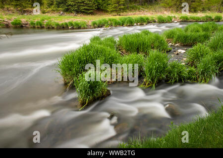 Fast flowing water of Junction Creek in spring, Greater Sudbury, Ontario, Canada - Stock Photo