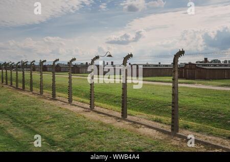 OSWIECIM, POLAND - AUGUST 17, 2019: Buildings in the concentration camp Auschwitz Birkenau in Oswiecim, Poland. - Stock Photo