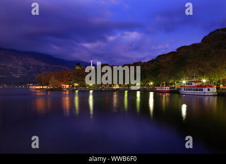 Part of the lakeside road of Ioannina town at night. Epirus periphery, Greece. - Stock Photo