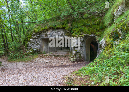 Entrance of Upper Military connection Tunnel between Fortress Kluze and Fort Hermann. Mining Tunnel for Izonso Front in Bovec, Gorizia, Slovenia. - Stock Photo
