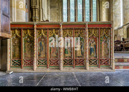 Part of the rood screen at Thornham showing the Old Testament prophets, L-R, St Barbara, St Paul, Amos, Hosea, Zechariah, Isaiah, David & Jeremiah. - Stock Photo