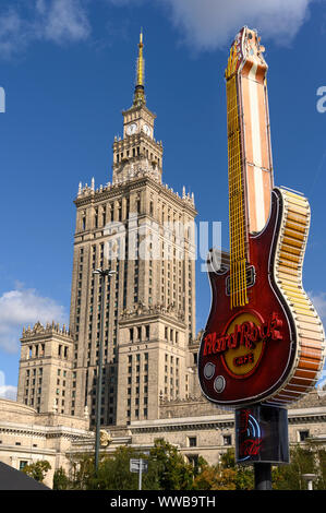 WARSAW, POLAND - SEPTEMBER 14, 2019. Citiscape with old Palace of Culture and Science of Warsaw and new symbol of Hard Rock Cafe in Warsaw, Poland. - Stock Photo