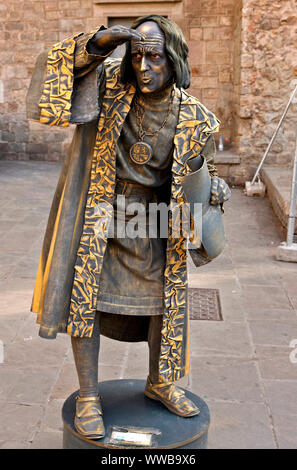 Street artist ('living statue') at Pla de la Seu (the Cathedral square), in Barri Gotic, the old Gothic district of Barcelona, Catalonia, Spain. - Stock Photo