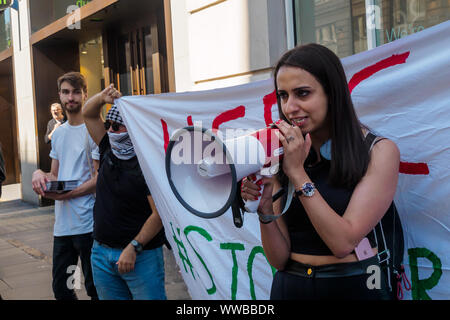 London, UK. 14th September 2019. Protesters outside the Oxford St branch of the HSBC Bank call on it to stop its support of military and technology companies that sell weapons and equipment to Israel to be used against Palestinians. HSBC has divested from Israel's largest private weapons company, but still owns shares in Caterpillar which supplies bulldozers to destroy Palestinian homes and construct illegal apartheid settlemetns. Credit: Peter Marshall/Alamy Live News - Stock Photo