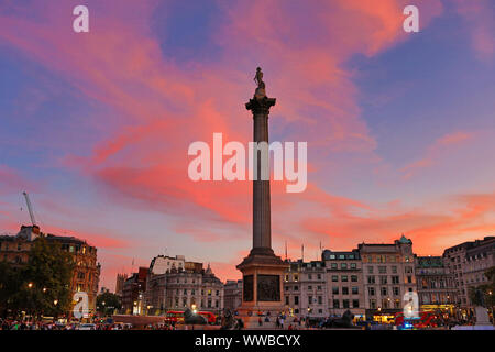London, UK. 14th September 2019. Amazing sunset behind Nelson's Column in Trafalgar Square, London, England Credit: Paul Brown/Alamy Live News - Stock Photo