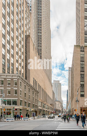 New York, NY, USA - December, 25th, 2018 - People crossing the streets of Manhattan, at Sixth Avenue with 49th West, near Magnolia Bakery. - Stock Photo