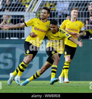 Dortmund, Germany. 14th Sep, 2019. Raphael Guerreiro (L, front) of Dortmund celebrates scoring during the Bundesliga soccer match between Borussia Dortmund and Bayer 04 Leverkusen in Dortmund, Germany, Sept. 14, 2019. Credit: Joachim Bywaletz/Xinhua Credit: Xinhua/Alamy Live News - Stock Photo