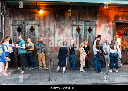 New Orleans, USA - April 22, 2018: People standing in line waiting for Preservation Hall in old town St Peter Pierre street in Louisiana - Stock Photo