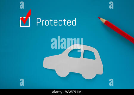 Car insurance concept. Paper car on blue background - Stock Photo