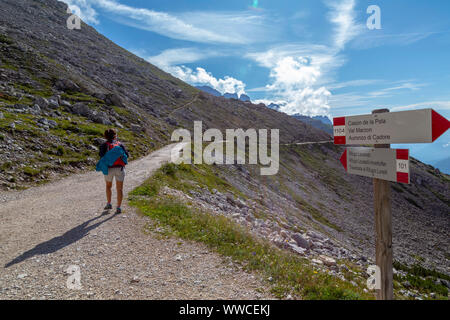 Girl walked in the direction of Lavaraedo refuge from the shelter of Auronzo, to make the well-known circular route of the Three Summits of Lavaredo ( - Stock Photo