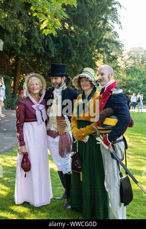 Jane Austen Festival 2019.  The Grand Regency Costumed Promenade where 500+ people from around the world join the official opening procession of the Jane Austen festival dressed in period costume. - Stock Photo