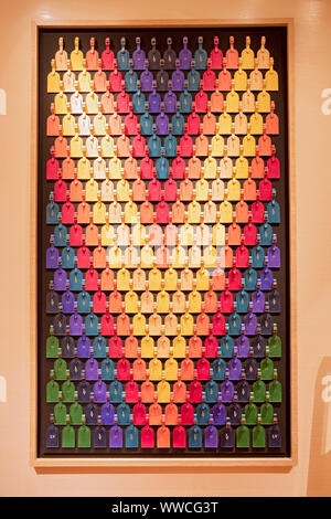 A very cleverly designed 'V' logo made out of different color luggage tags at the Vuitton store in Bloomingdale's in Manhattan, New York City. - Stock Photo
