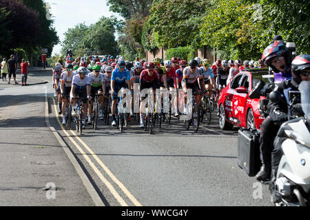 Cyclists in the 2019 OVO Energy Tour of Britain men`s cycle race. - Stock Photo