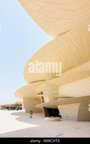 Tourists at the desert rose inspired architectural landmark of the National Museum of Qatar, Doha, Qatar - Stock Photo