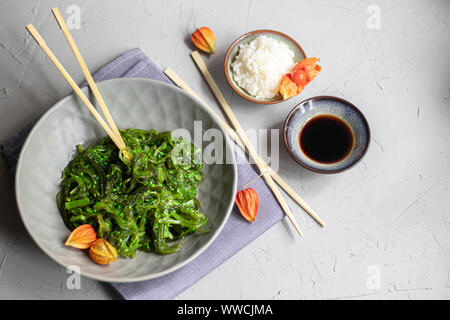 Seaweed Salad. Dietary and very beneficial for the thyroid gland. Dressed with vegetable oil, sprinkled with sesame seeds. - Stock Photo