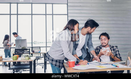creative designer team argument at casual meeting table and walk out from meeting in modern office.tea,m conflict concept - Stock Photo