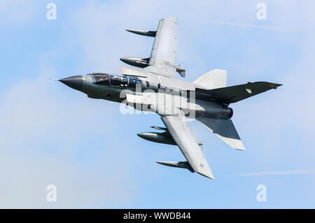 A Panavia Tornado GR4 multirole aircraft of the Royal Air Force (RAF) performs an aerobatic display. - Stock Photo