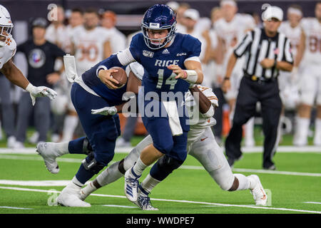 September 14, 2019: Rice Owls quarterback Tom Stewart (14) scrambles during the 3rd quarter of an NCAA football game between the Texas Longhorns and the Rice Owls at NRG Stadium in Houston, TX. Texas won the game 48 to 13...Trask Smith/CSM - Stock Photo
