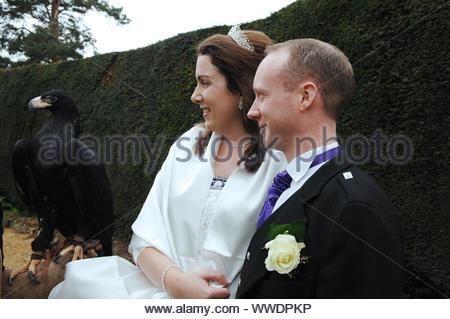 Wedding Couple at Burton Court, Herefordshire with Black Eagle - Stock Photo