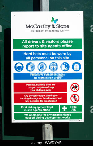 Building site safety information sign - Stock Photo